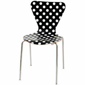 Sedia con gambe cromate e scocca fondo nero a pois bianchi