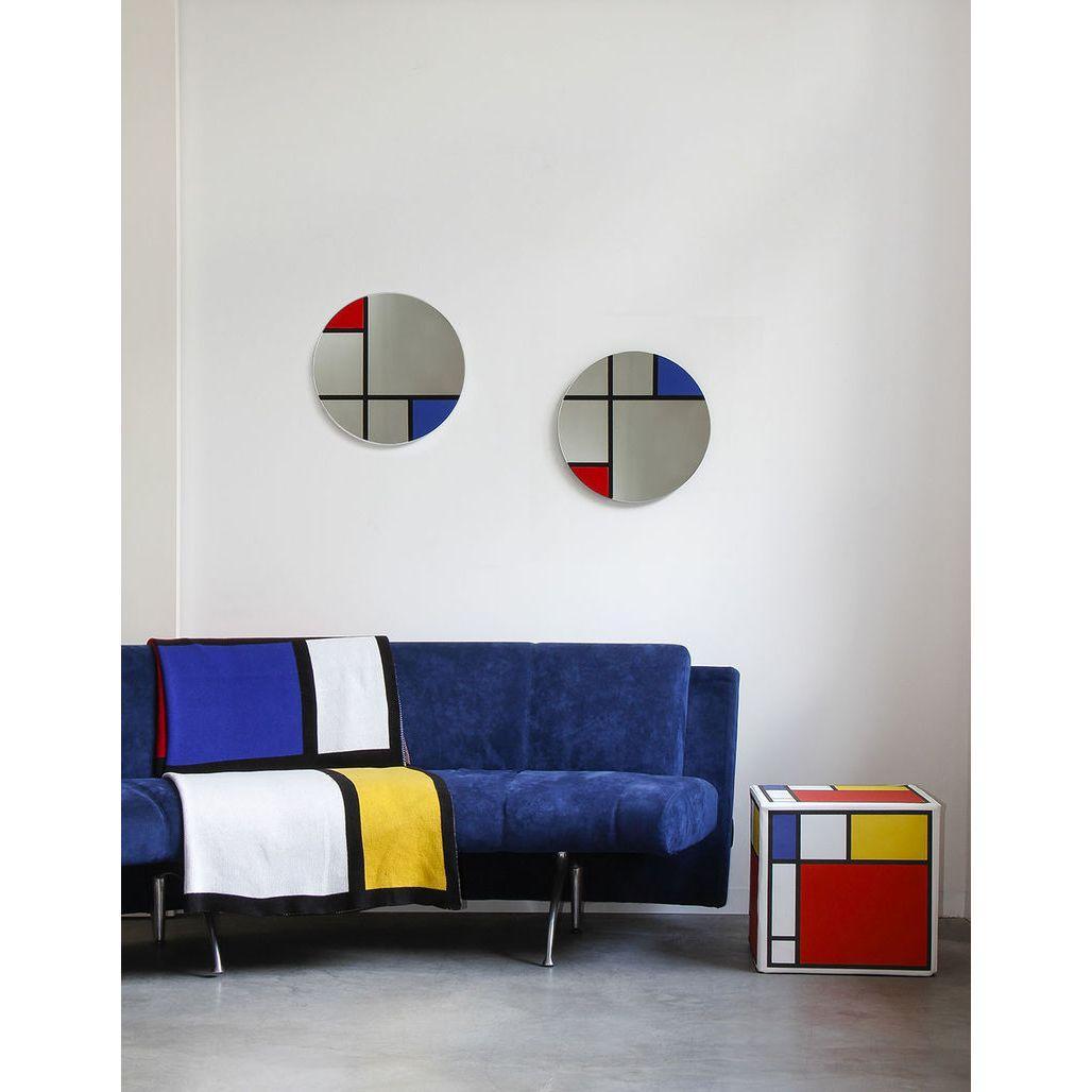 Specchio in vetro circolare con grafica ispirata a Mondrian