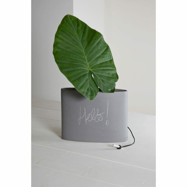 vaso in ceramica smaltato simil cemento con una grande foglia verde