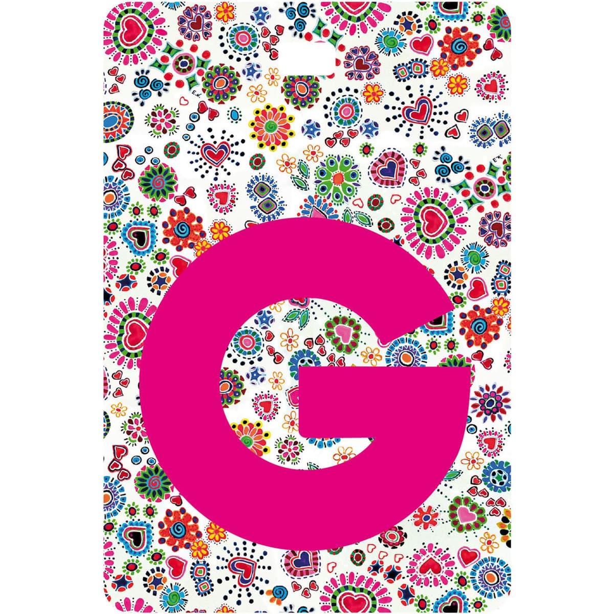 Etichetta bagaglio con lettera alfabeto bianca su sfondo fantasia cuori e fiori colorati con iniziale G