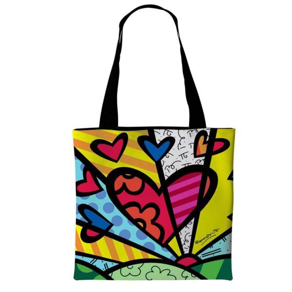 borsa di tipo tote bag in morbida ecopelle con grafica di cuore stilizzato di Romero Britto